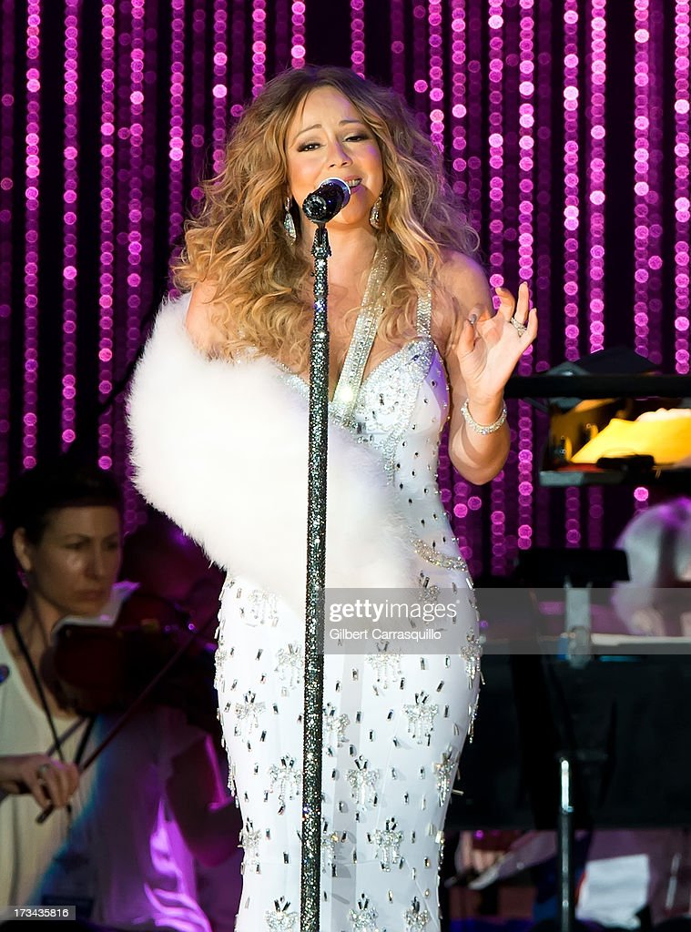 <a gi-track='captionPersonalityLinkClicked' href=/galleries/search?phrase=Mariah+Carey&family=editorial&specificpeople=171647 ng-click='$event.stopPropagation()'>Mariah Carey</a> performs on stage during 2013 Major League Baseball All-Star Charity Concert starring The New York Philharmonic with Special Guest <a gi-track='captionPersonalityLinkClicked' href=/galleries/search?phrase=Mariah+Carey&family=editorial&specificpeople=171647 ng-click='$event.stopPropagation()'>Mariah Carey</a> Benefiting Sandy Relief at Central Park, Great Lawn on July 13, 2013 in New York City.