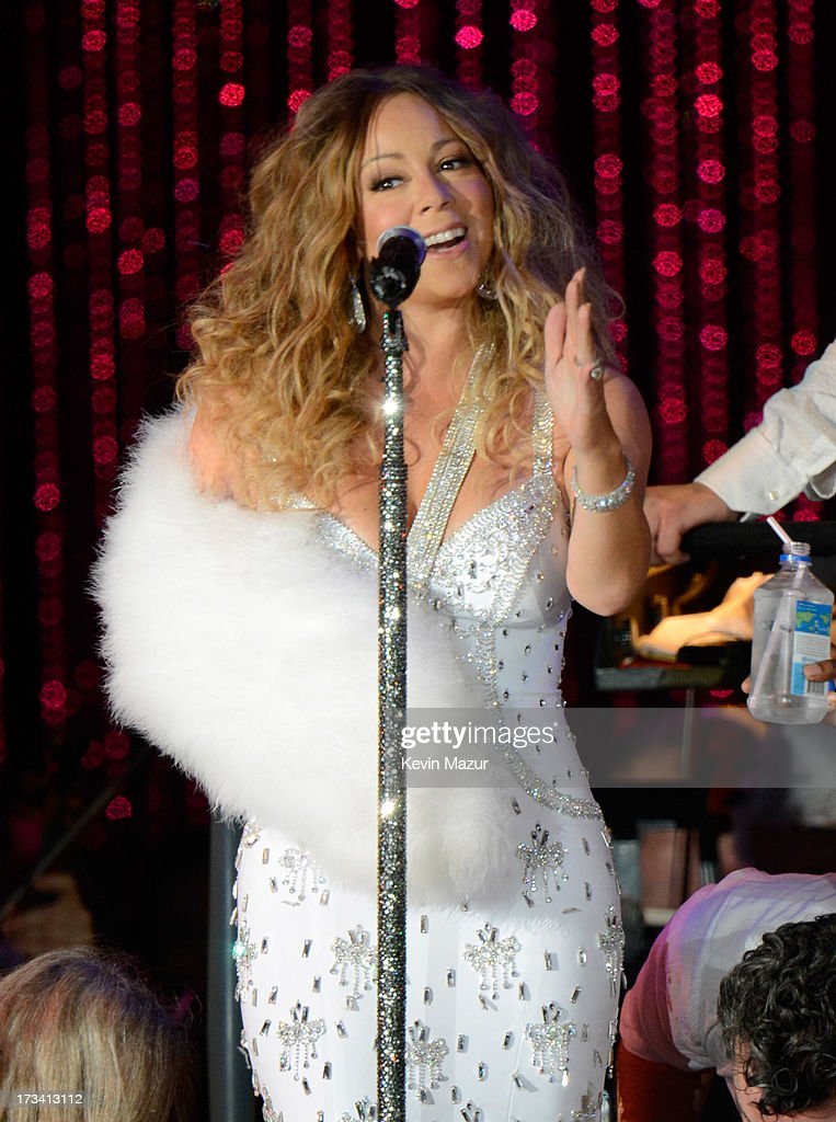 <a gi-track='captionPersonalityLinkClicked' href=/galleries/search?phrase=Mariah+Carey&family=editorial&specificpeople=171647 ng-click='$event.stopPropagation()'>Mariah Carey</a> performs on stage during MLB All Star Charity Concert starring The New York Philharmonic with Special Guest <a gi-track='captionPersonalityLinkClicked' href=/galleries/search?phrase=Mariah+Carey&family=editorial&specificpeople=171647 ng-click='$event.stopPropagation()'>Mariah Carey</a> Benefiting Sandy Relief at Central Park, Great Lawn on July 13, 2013 in New York City.