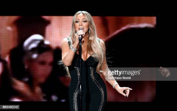 Mariah Carey performs onstage during the AHF World AIDS DAY Concert and 30th Anniversary Celebration featuring Mariah Carey and DJ Khaled at the...