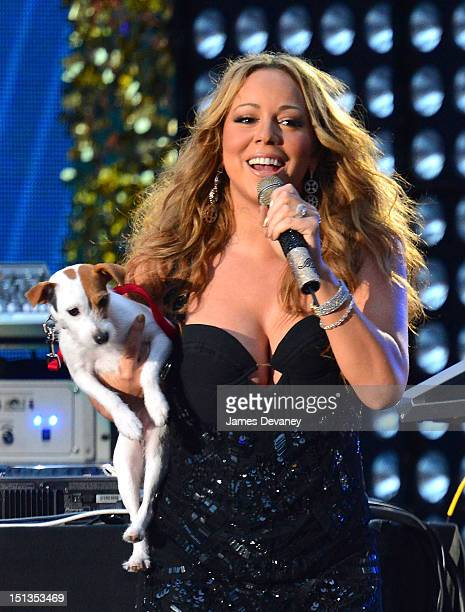 Mariah Carey performs with her dog during the 2012 NFL KickOff Concert in Rockefeller Center on September 5 2012 in New York City