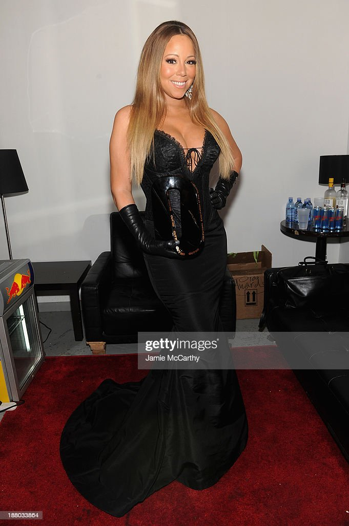 Mariah Carey poses at the 19th Annual Out100 Awards presented by Buick at Terminal 5 on November 14, 2013 in New York City.