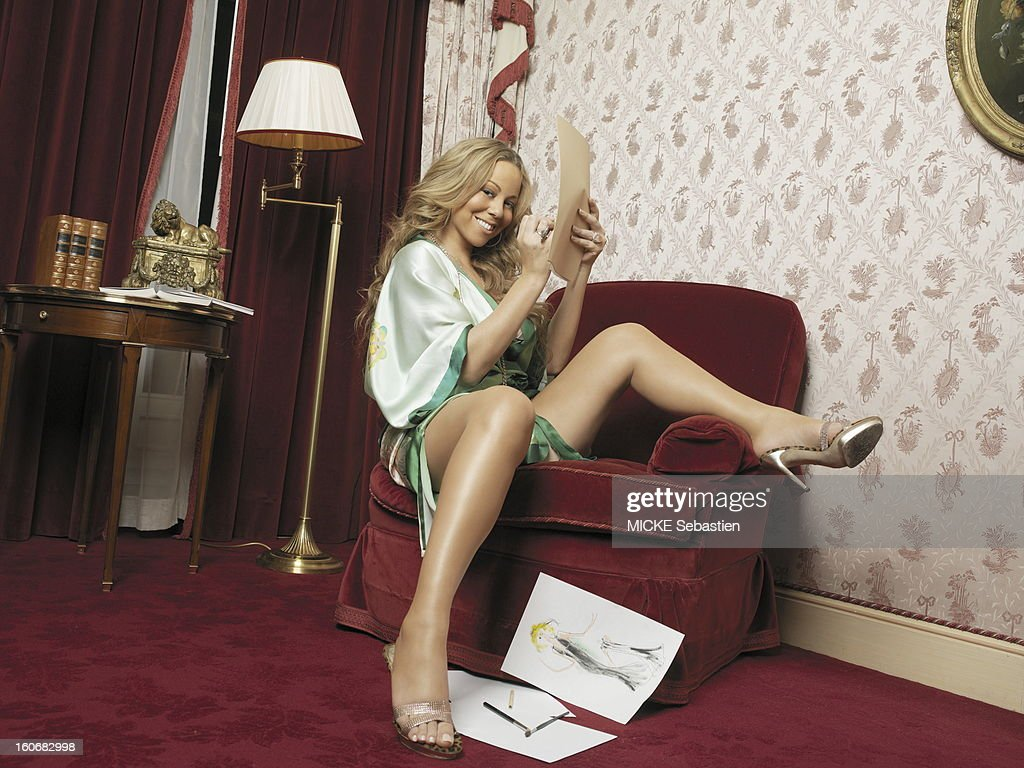 Mariah Carey sexy attitude in spotlighting undress her legs sitting in a chair in Suite 201 of the George V hotel in PARIS drawing photographer...