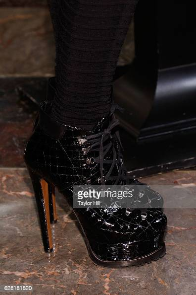 Mariah Carey shoe detail visits the Empire State Building on December 6 2016 in New York City