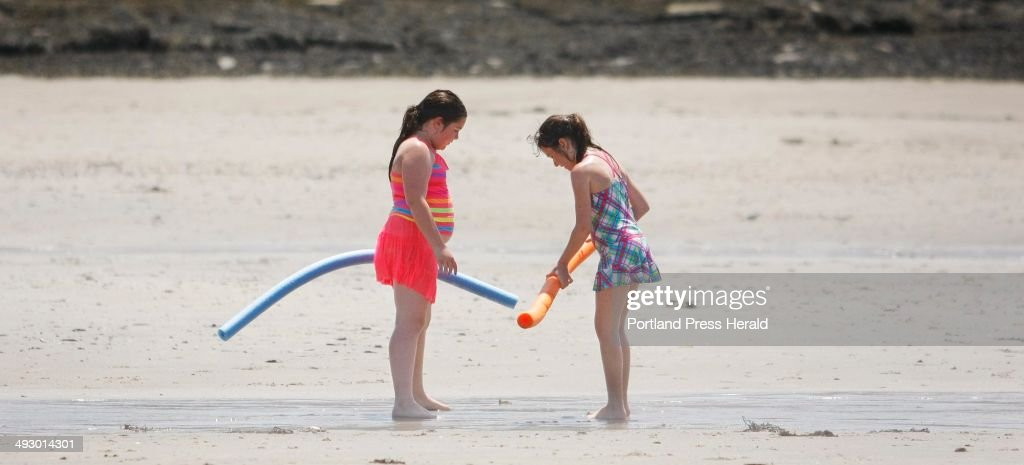 Mariah Coyne left and Seneca Ward both of Portland inspect the beach at Kettle Cove after taking a swim Sunday June 2 in Cape Elizabeth The friends...