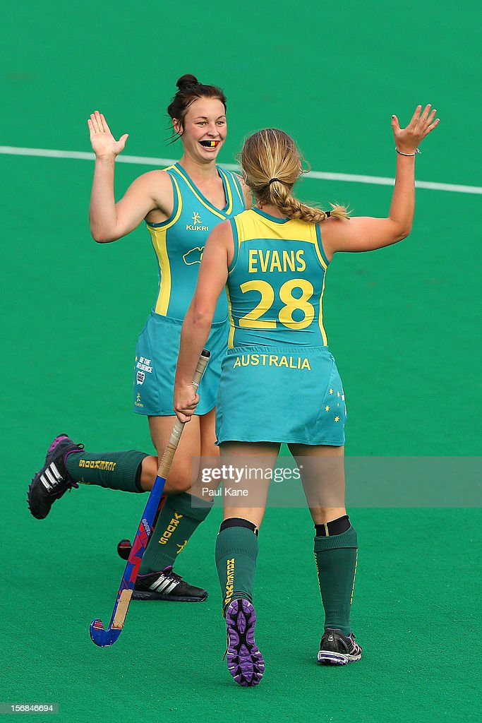 Mariah Williams and Naomi Evans of the Jillaroos celebrate a goal in the womens Australia u21 Jillaroos v Malaysia game during day two of the 2012 International Super Series at Perth Hockey Stadium on November 23, 2012 in Perth, Australia.