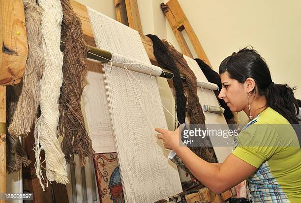Mariam Harutyunyan A woman makes a carpet in a workshop in Echmiadzin on September 9 2011 People in Armenia as in other Caucasus and Central Asian...