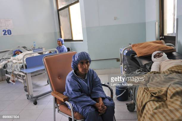 Mariam sits by her daughter Najiba in the burn center of the Herat Regional Hospital in Herat Afghanistan August 3 2010 Najiba who had been married 6...