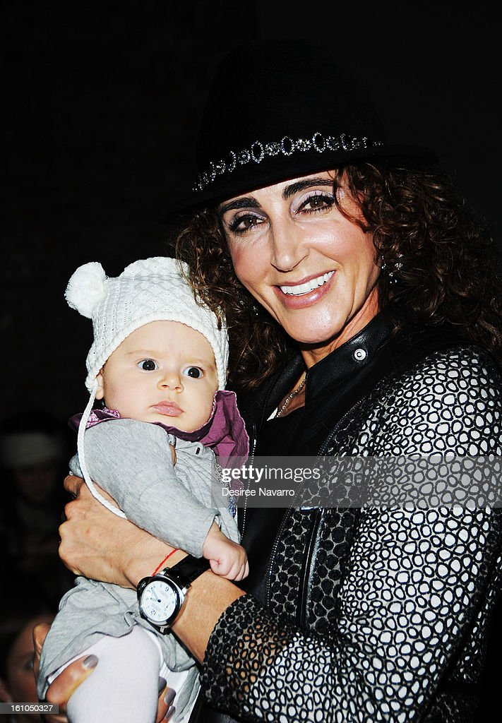 Mariam Smrcrich with baby Noi attend Yigal Azrouel during Fall 2013 Mercedes-Benz Fashion Week at Highline Stages on February 8, 2013 in New York City.