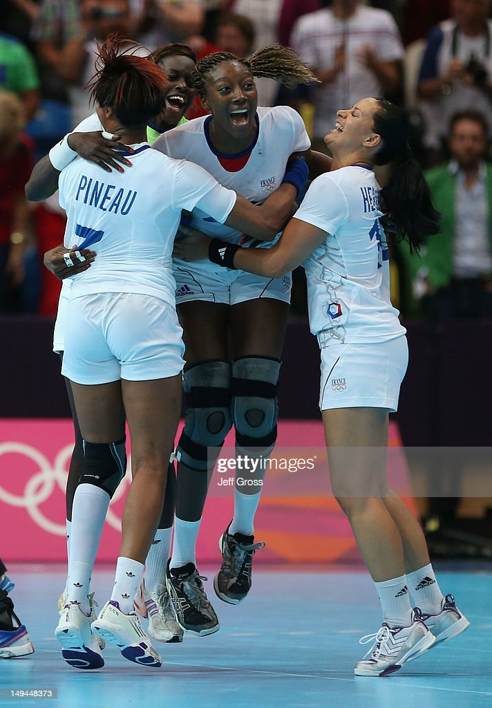 <a gi-track='captionPersonalityLinkClicked' href=/galleries/search?phrase=Mariama+Signate&family=editorial&specificpeople=2206555 ng-click='$event.stopPropagation()'>Mariama Signate</a> of France celebrates victory with team mates in the Women's Handball preliminaries Group B - Match 6 between Norway and France on Day 1 of the London 2012 Olympic Games at the Copper Box on July 28, 2012 in London, England.