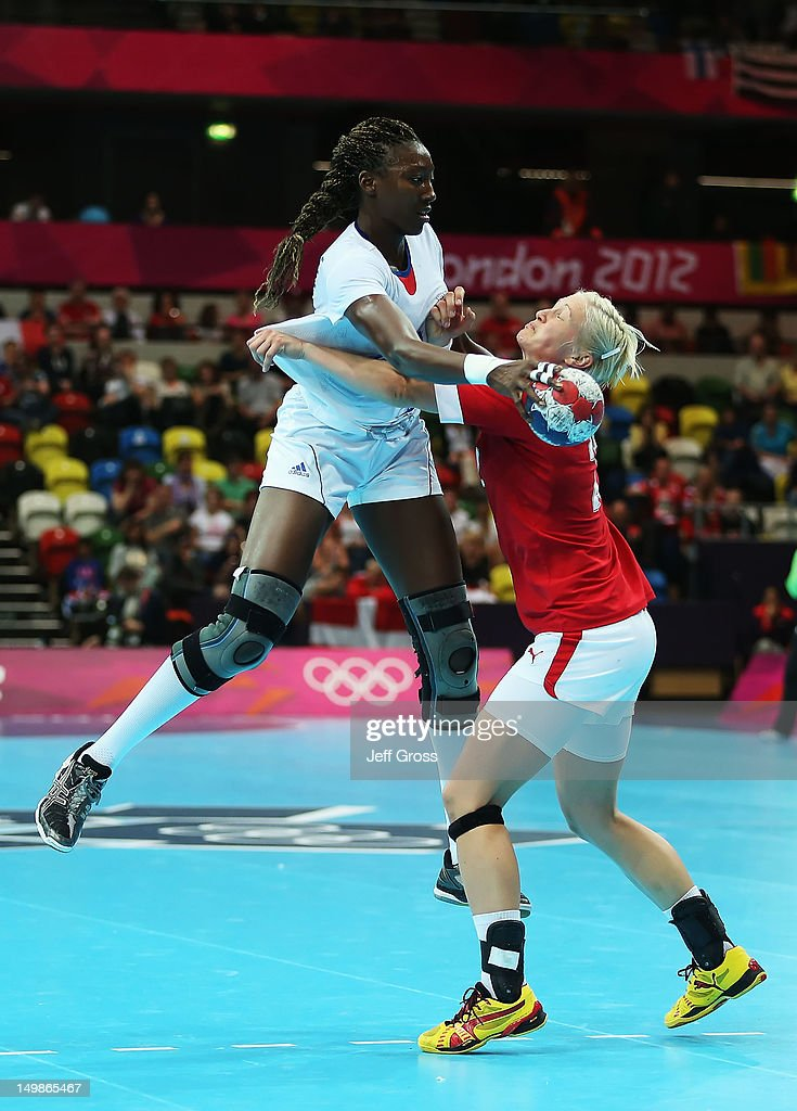 <a gi-track='captionPersonalityLinkClicked' href=/galleries/search?phrase=Mariama+Signate&family=editorial&specificpeople=2206555 ng-click='$event.stopPropagation()'>Mariama Signate</a> #24 of France is defended by Rikke Skov #25 of Denmark during the Women's Handball Preliminaries Group B match between Denmark and France on Day 9 of the London 2012 Olympic Games at the Copper Box on August 5, 2012 in London, England.