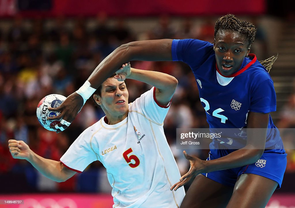 <a gi-track='captionPersonalityLinkClicked' href=/galleries/search?phrase=Mariama+Signate&family=editorial&specificpeople=2206555 ng-click='$event.stopPropagation()'>Mariama Signate</a> #24 of France is pursued by Ana Dokic #5 of Montenegro during the Women's Quarterfinal match between France and Montenegro on Day 11 of the London 2012 Olympic Games at The Copper Box on August 7, 2012 in London, England.