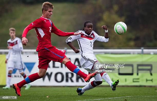 Marian Burda of Czech Republic battles for the ball with Alfons Amade of Germany during the international friendly match between U16 Czech Republic...