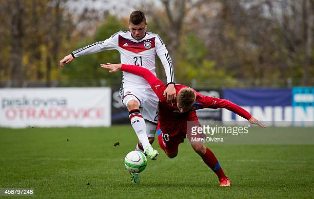 Marian Burda of Czech Republic battles for the ball with Renat Dadachov of Germany during the international friendly match between U16 Czech Republic...