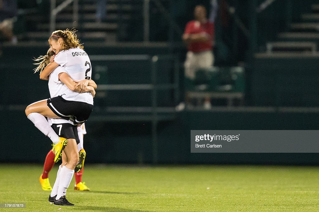 Marian Dougherty #2 jumps into the arms of Nikki Marshall #7 following Portland Thorns FC win over Western New York Flash in the National Women's Soccer League Championship at Sahlen's Stadium August 31, 2013 in Rochester, New York.