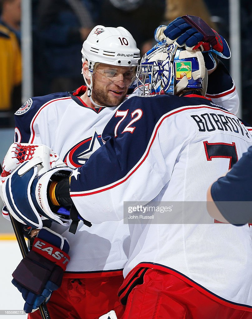 Marian Gaborik #10 congratulates goalie Sergei Bobrovsky #72 of the Columbus Blue Jackets after defeating the Nashville Predators during an NHL game at the Bridgestone Arena on April 4, 2013 in Nashville, Tennessee.