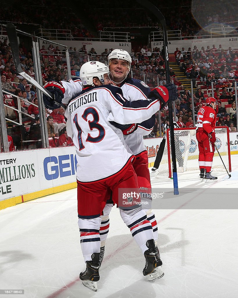<a gi-track='captionPersonalityLinkClicked' href=/galleries/search?phrase=Marian+Gaborik&family=editorial&specificpeople=202477 ng-click='$event.stopPropagation()'>Marian Gaborik</a> #10 hugs teammate <a gi-track='captionPersonalityLinkClicked' href=/galleries/search?phrase=Cam+Atkinson&family=editorial&specificpeople=6270272 ng-click='$event.stopPropagation()'>Cam Atkinson</a> #13 of the Columbus Blue Jackets after scoring a 2nd period goal during a NHL game against the Detroit Red Wings at Joe Louis Arena on October 15, 2013 in Detroit, Michigan.