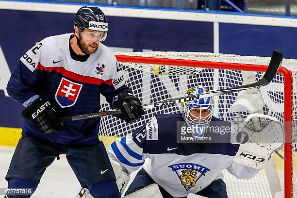 Marian Gaborik of Slovakia and Juuse Saros goalkeeper of Finland look at the puck during the IIHF World Championship group B match between Finland...