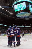 Marian Gaborik of Slovakia celebrates his second period goal with his teammates against the Czech Republic during the ice hockey men's preliminary...