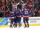 Marian Gaborik of Slovakia celebrates with his team after scoring a goal in the second period during the ice hockey men's bronze medal game between...