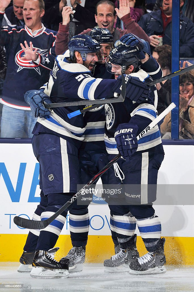<a gi-track='captionPersonalityLinkClicked' href=/galleries/search?phrase=Marian+Gaborik&family=editorial&specificpeople=202477 ng-click='$event.stopPropagation()'>Marian Gaborik</a> #10 of the Columbus Blue Jackets celebrates his third period goal against the St. Louis Blues, assisted by teammates <a gi-track='captionPersonalityLinkClicked' href=/galleries/search?phrase=Mark+Letestu&family=editorial&specificpeople=4601071 ng-click='$event.stopPropagation()'>Mark Letestu</a> #55 and Vinny Prospal #22 on April 12, 2013 at Nationwide Arena in Columbus, Ohio. Columbus defeated St. Louis 4-1.