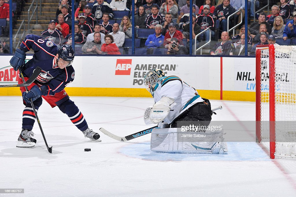 <a gi-track='captionPersonalityLinkClicked' href=/galleries/search?phrase=Marian+Gaborik&family=editorial&specificpeople=202477 ng-click='$event.stopPropagation()'>Marian Gaborik</a> #10 of the Columbus Blue Jackets scores on goaltender <a gi-track='captionPersonalityLinkClicked' href=/galleries/search?phrase=Antti+Niemi&family=editorial&specificpeople=213913 ng-click='$event.stopPropagation()'>Antti Niemi</a> #31 of the San Jose Sharks during the third period on April 9, 2013 at Nationwide Arena in Columbus, Ohio. Columbus defeated San Jose 4-0.
