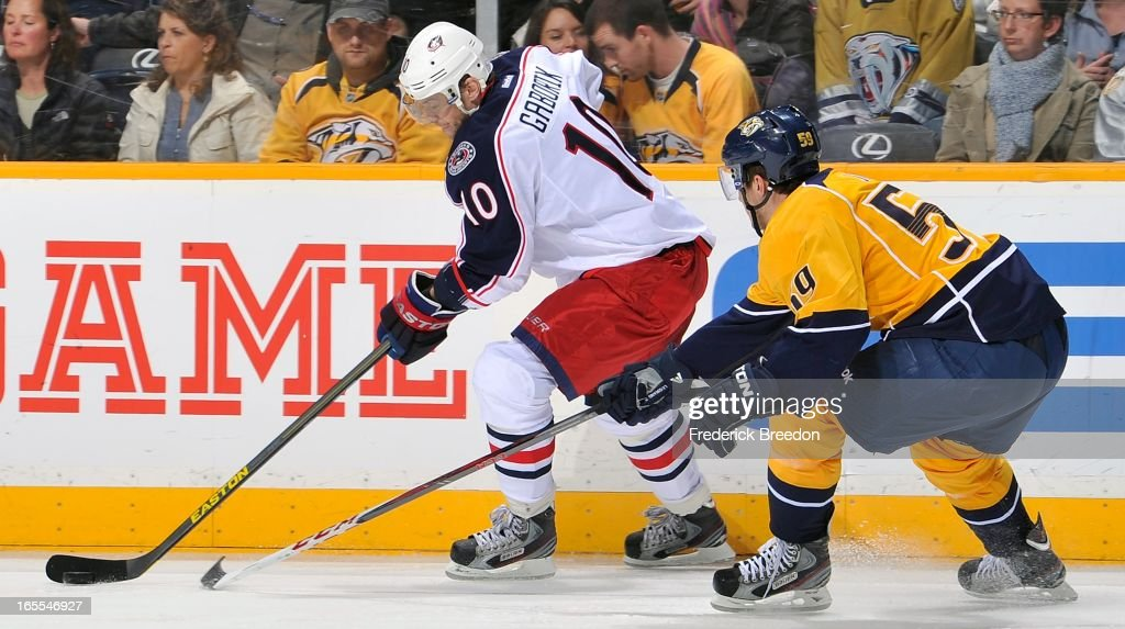<a gi-track='captionPersonalityLinkClicked' href=/galleries/search?phrase=Marian+Gaborik&family=editorial&specificpeople=202477 ng-click='$event.stopPropagation()'>Marian Gaborik</a> #10 of the Columbus Blue Jackets skates against Taylor Beck #56 of the Nashville Predators at the Bridgestone Arena on April 4, 2013 in Nashville, Tennessee.