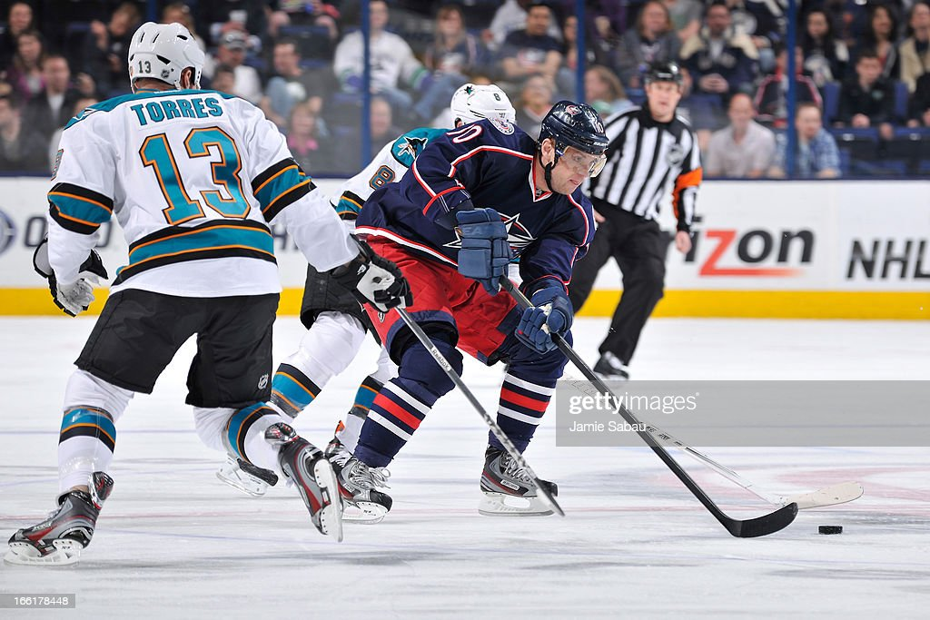 Marian Gaborik #10 of the Columbus Blue Jackets skates the puck around Raffi Torres #13 of the San Jose Sharks during the first period on April 9, 2013 at Nationwide Arena in Columbus, Ohio.