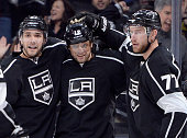 Marian Gaborik of the Los Angeles Kings celebrates his power play goal with Alec Martinez and Jeff Carter of the Los Angeles Kings to tie the game 22...