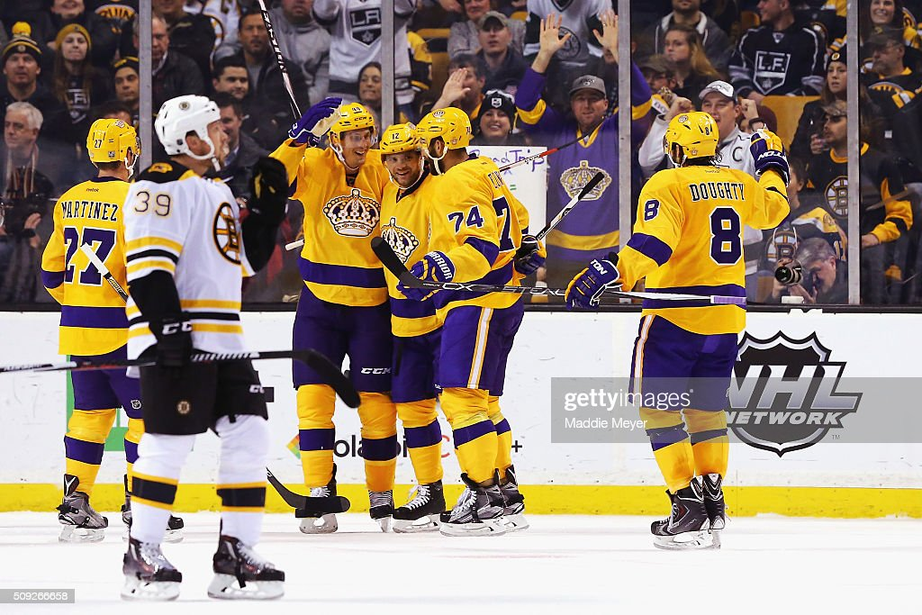 Marian Gaborik #12 of the Los Angeles Kings celebrates with Alec Martinez #27, Vincent Lecavalier #44, Dwight King #74 and Drew Doughty #8 after scoring against the Boston Bruins during the first period at TD Garden on February 9, 2016 in Boston, Massachusetts.