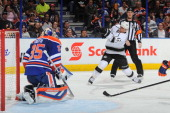 Marian Gaborik of the Los Angeles Kings takes a shot on Viktor Fasth of the Edmonton Oilers on April 10 2014 at Rexall Place in Edmonton Alberta...