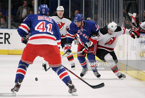 Marian Gaborik of the New York Rangers and Petr Sykora of the New Jersey Devils vie for the puck in Game One of the Eastern Conference Final during...