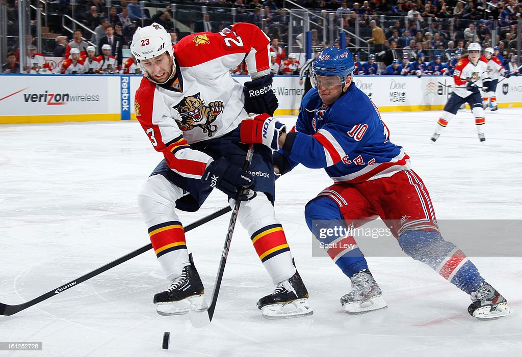Marian Gaborik #10 of the New York Rangers attempts to poke the puck away from Tyson Strachan #23 of the Florida Panthers at Madison Square Garden on March 21, 2013 in New York City.