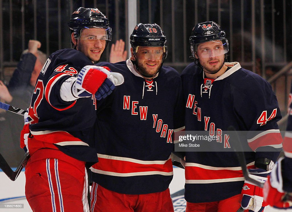 Marian Gaborik of the New York Rangers celebrates a second period goal with teammates Steve Eminger and Artem Anisimov during the game against the...