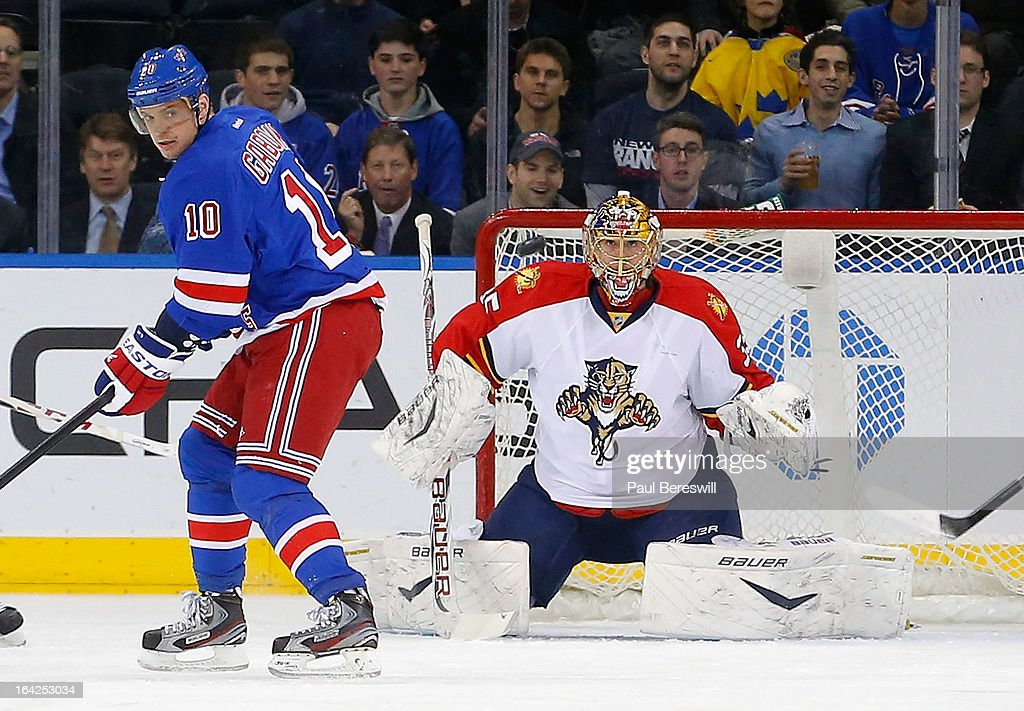 Marian Gaborik #10 of the New York Rangers looks for the puck as goalie Jacob Markstrom #35 of the Florida Panthers keeps his eye on it during the first period of an NHL hockey game at Madison Square Garden on March 21, 2013 in New York City. Panthers won 3-1.