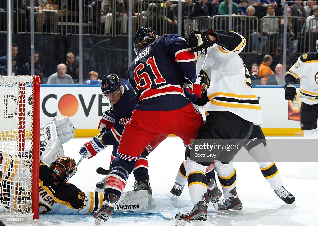 <a gi-track='captionPersonalityLinkClicked' href=/galleries/search?phrase=Marian+Gaborik&family=editorial&specificpeople=202477 ng-click='$event.stopPropagation()'>Marian Gaborik</a> #10 of the New York Rangers scores a goal in the first period against <a gi-track='captionPersonalityLinkClicked' href=/galleries/search?phrase=Tuukka+Rask&family=editorial&specificpeople=716723 ng-click='$event.stopPropagation()'>Tuukka Rask</a> #40 of the Boston Bruins at Madison Square Garden on January 23, 2013 in New York City.