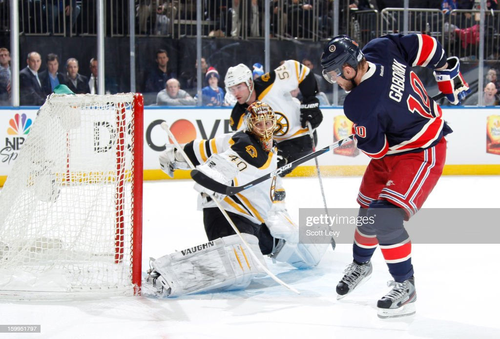 <a gi-track='captionPersonalityLinkClicked' href=/galleries/search?phrase=Marian+Gaborik&family=editorial&specificpeople=202477 ng-click='$event.stopPropagation()'>Marian Gaborik</a> #10 of the New York Rangers scores a hat-trick as the game-winning goal in overtime against <a gi-track='captionPersonalityLinkClicked' href=/galleries/search?phrase=Tuukka+Rask&family=editorial&specificpeople=716723 ng-click='$event.stopPropagation()'>Tuukka Rask</a> #40 of the Boston Bruins at Madison Square Garden on January 23, 2013 in New York City. The Rangers defeat the Bruins 4-3 in overtime.