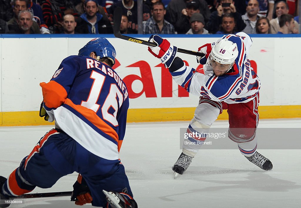 <a gi-track='captionPersonalityLinkClicked' href=/galleries/search?phrase=Marian+Gaborik&family=editorial&specificpeople=202477 ng-click='$event.stopPropagation()'>Marian Gaborik</a> #10 of the New York Rangers scores a powerplay goal at 42 seconds of overtime to defeat the New York Islanders 2-1 at the Nassau Veterans Memorial Coliseum on March 7, 2013 in Uniondale, New York.