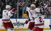 Marian Gaborik of the New York Rangers scores a powerplay goal at 42 seconds of overtime to defeat the New York Islanders 21 and is joined by Rick...