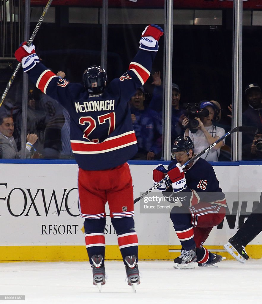<a gi-track='captionPersonalityLinkClicked' href=/galleries/search?phrase=Marian+Gaborik&family=editorial&specificpeople=202477 ng-click='$event.stopPropagation()'>Marian Gaborik</a> #10 of the New York Rangers scores his third goal of the game in overtime to defeat the Boston Bruins, and is joined by <a gi-track='captionPersonalityLinkClicked' href=/galleries/search?phrase=Ryan+McDonagh&family=editorial&specificpeople=4324983 ng-click='$event.stopPropagation()'>Ryan McDonagh</a> #27 at Madison Square Garden on January 23, 2013 in New York City.