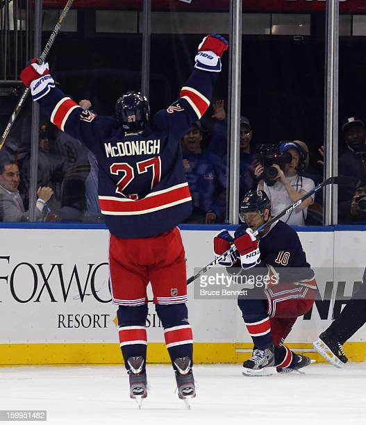 Marian Gaborik of the New York Rangers scores his third goal of the game in overtime to defeat the Boston Bruins and is joined by Ryan McDonagh at...