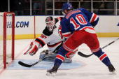 Marian Gaborik of the New York Rangers shoots a goal past goalkeeper Martin Brodeur of the New Jersey Devils during their game on February 6 2010 at...