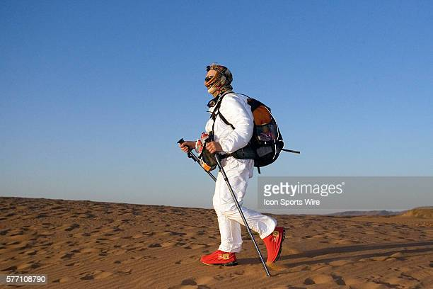 Marian Gray of Ireland arrives at the bivouac as the sun rises after almost a 24 hours stage running and walking during fourth and longest stage of...