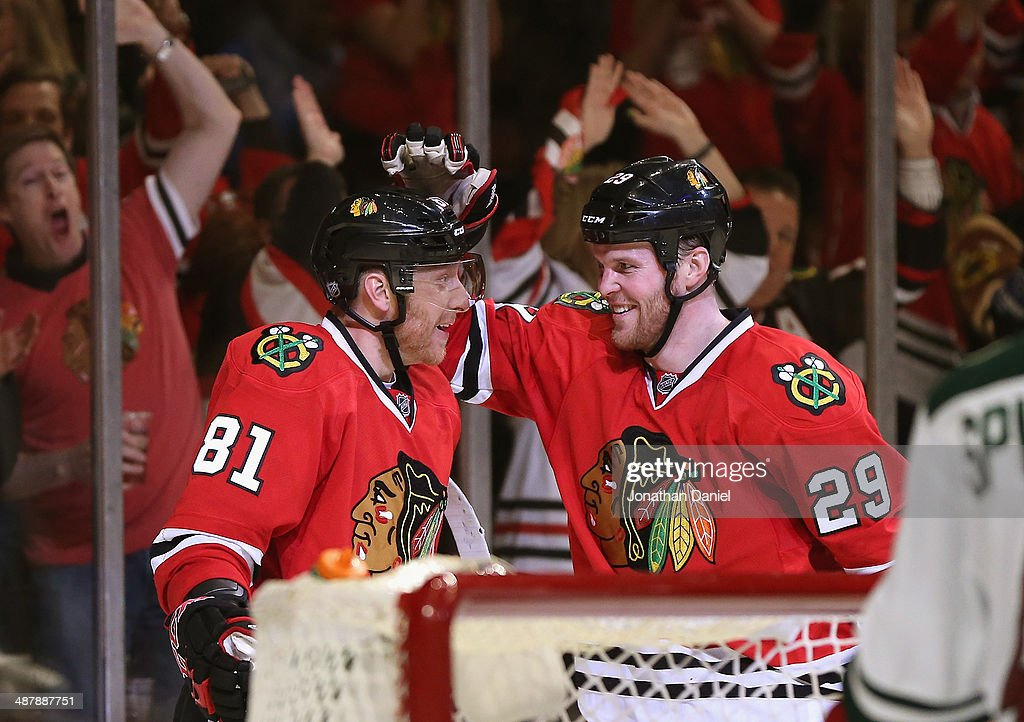 <a gi-track='captionPersonalityLinkClicked' href=/galleries/search?phrase=Marian+Hossa&family=editorial&specificpeople=202233 ng-click='$event.stopPropagation()'>Marian Hossa</a> #81 and <a gi-track='captionPersonalityLinkClicked' href=/galleries/search?phrase=Bryan+Bickell&family=editorial&specificpeople=241498 ng-click='$event.stopPropagation()'>Bryan Bickell</a> #29 of the Chicago Blackhawks celebrate Hossa's second period goal against the Minnesota Wild in Game One of the Second Round of the 2014 NHL Stanley Cup Playoffs at the United Center on May 2, 2014 in Chicago, Illinois.