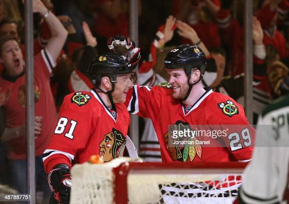 Marian Hossa and Bryan Bickell of the Chicago Blackhawks celebrate Hossa's second period goal against the Minnesota Wild in Game One of the Second...