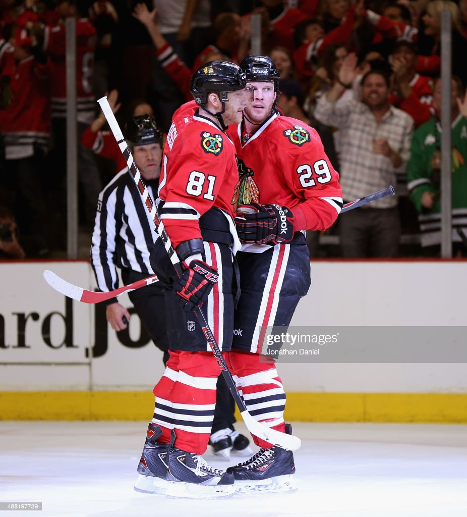 Marian Hossa #81 and Bryan Bickell #29 of the Chicago Blackhawks celebrate Bickell's third period goal against the Minnesota Wild in Game Two of the Second Round of the 2014 NHL Stanley Cup Playoffs at the United Center on May 4, 2014 in Chicago, Illinois. The Blackhawks defeated the Wild 4-1.