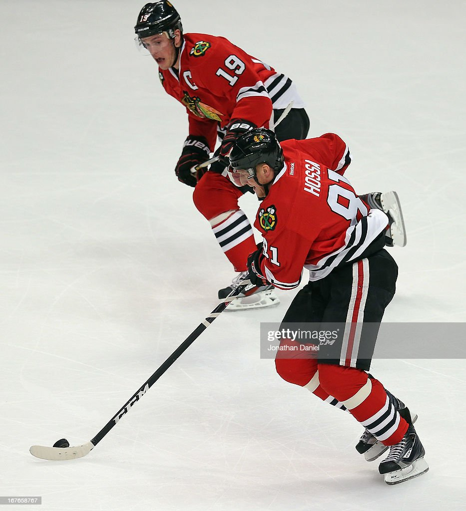 <a gi-track='captionPersonalityLinkClicked' href=/galleries/search?phrase=Marian+Hossa&family=editorial&specificpeople=202233 ng-click='$event.stopPropagation()'>Marian Hossa</a> #81 and <a gi-track='captionPersonalityLinkClicked' href=/galleries/search?phrase=Jonathan+Toews&family=editorial&specificpeople=537799 ng-click='$event.stopPropagation()'>Jonathan Toews</a> #19 of the Chicago Blackhawks break up the ice against the Calgary Flames at the United Center on April 26, 2013 in Chicago, Illinois. The Blackhawks defeated the Flames 3-1.