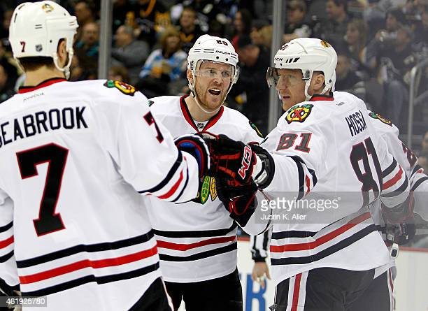 Marian Hossa celebrates after scoring in the second period with Bryan Bickell and Brent Seabrook of the Chicago Blackhawks during the game against...