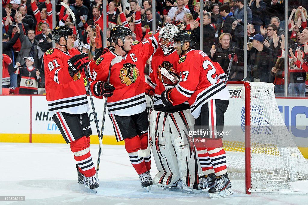 <a gi-track='captionPersonalityLinkClicked' href=/galleries/search?phrase=Marian+Hossa&family=editorial&specificpeople=202233 ng-click='$event.stopPropagation()'>Marian Hossa</a> #8, <a gi-track='captionPersonalityLinkClicked' href=/galleries/search?phrase=Jonathan+Toews&family=editorial&specificpeople=537799 ng-click='$event.stopPropagation()'>Jonathan Toews</a> #19 and <a gi-track='captionPersonalityLinkClicked' href=/galleries/search?phrase=Johnny+Oduya&family=editorial&specificpeople=3944055 ng-click='$event.stopPropagation()'>Johnny Oduya</a> #27 of the Chicago Blackhawks celebrate with goalie <a gi-track='captionPersonalityLinkClicked' href=/galleries/search?phrase=Ray+Emery&family=editorial&specificpeople=218109 ng-click='$event.stopPropagation()'>Ray Emery</a> #30 after the NHL game against the San Jose Sharks on February 22, 2013 at the United Center in Chicago, Illinois.