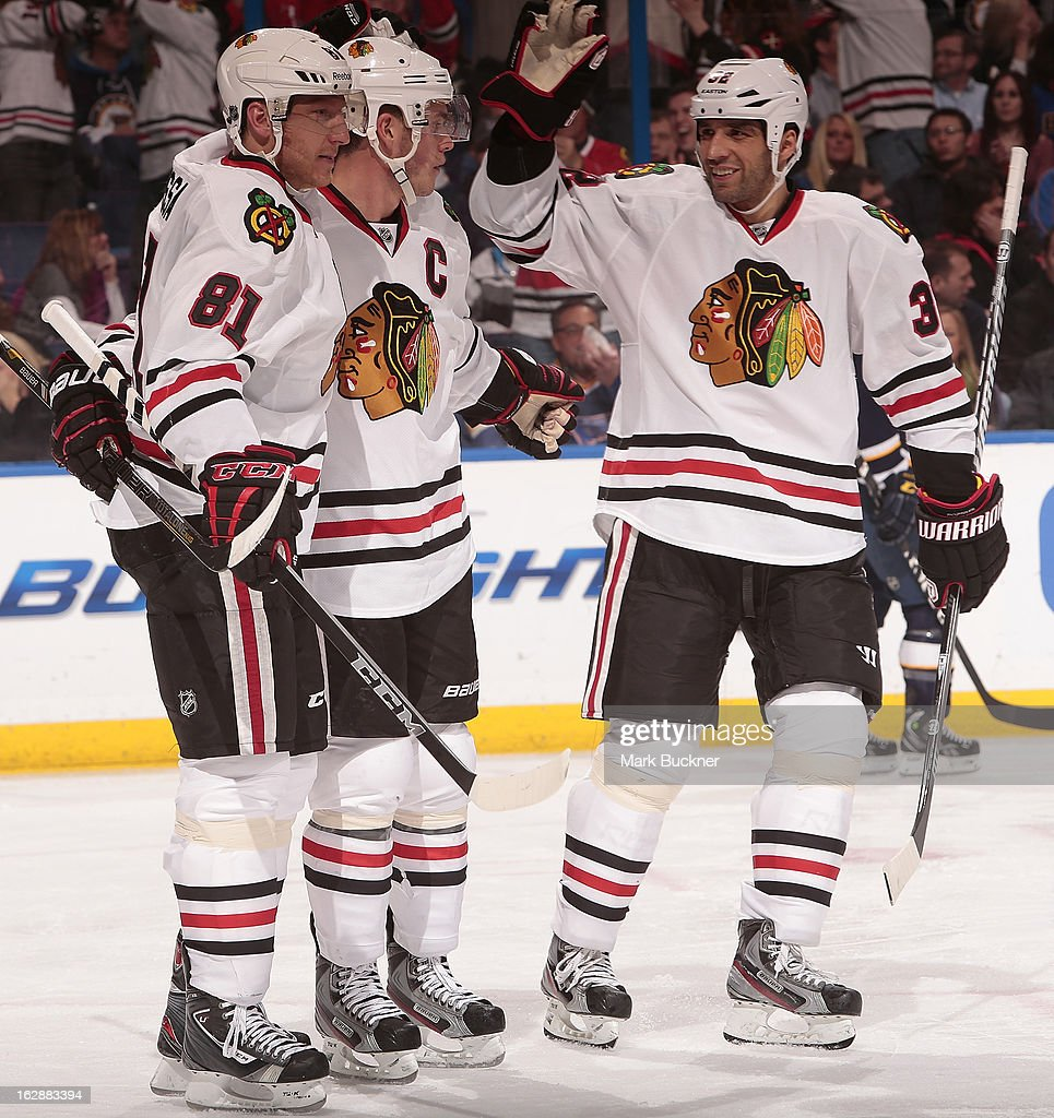 <a gi-track='captionPersonalityLinkClicked' href=/galleries/search?phrase=Marian+Hossa&family=editorial&specificpeople=202233 ng-click='$event.stopPropagation()'>Marian Hossa</a> #81, <a gi-track='captionPersonalityLinkClicked' href=/galleries/search?phrase=Jonathan+Toews&family=editorial&specificpeople=537799 ng-click='$event.stopPropagation()'>Jonathan Toews</a> #19 and <a gi-track='captionPersonalityLinkClicked' href=/galleries/search?phrase=Michal+Rozsival&family=editorial&specificpeople=216462 ng-click='$event.stopPropagation()'>Michal Rozsival</a> #32 of the Chicago Blackhawks celebrate a goal in an NHL game against the St. Louis Blues on February 28, 2013 at Scottrade Center in St. Louis, Missouri.