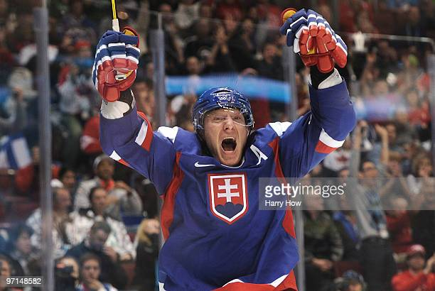 Marian Hossa of Slovakia celebrates after scoring a goal past Miikka Kiprusoff of Finland in the second period during the ice hockey men's bronze...